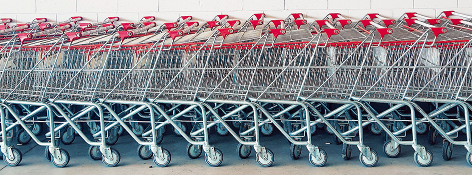A stack of trolleys, representing the move from physical stores to eCommerce and D2C Marketing